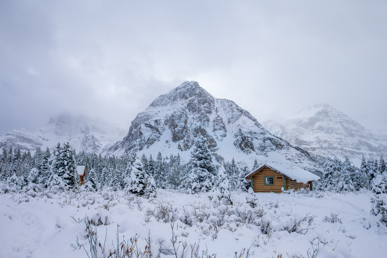 Fog, Cabin and Snow at Mount Assiniboine Provincial Park, Canada.